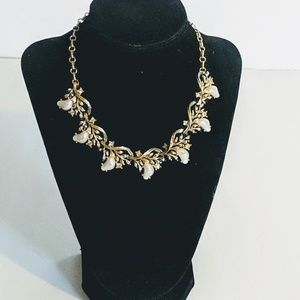 Gold toned choker with rhinestones and pearlsL